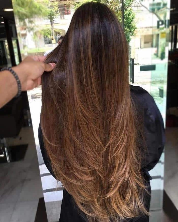 corte de cabelo longo iluminado